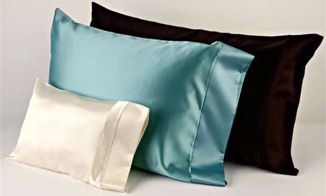 Sleeping with a satin pillow case causes less frizz than sleeping with a cotton pillow case. It makes a big difference guys!