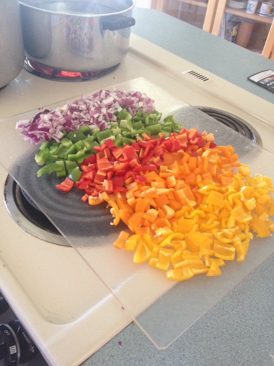 Start with dicing your veggies: 1 cup red onion, green & red bell pepper, orange & yellow hot peppers