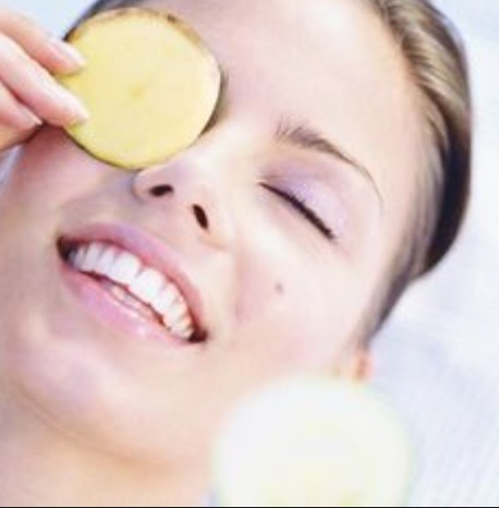 De-puff your eyes with raw potatoes. Raw potatoes have enzymes that help lighten your dark under eye circles! Wash and peel a potato, cut two slices and place on on each eye for 10 minutes. Lay down relax and let the potatoes work their magic. Rinse the eyes with lukewarm water and your done!