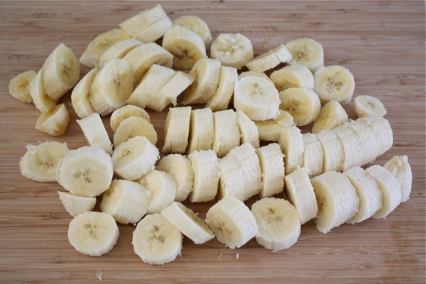 Slice up four ripe bananas and put them on a large plate. Put them in the freezer and let them chill until they are frozen-about two hours.
