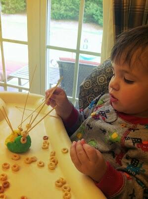Homemade Playdough + spaghetti noodles + Cheerios