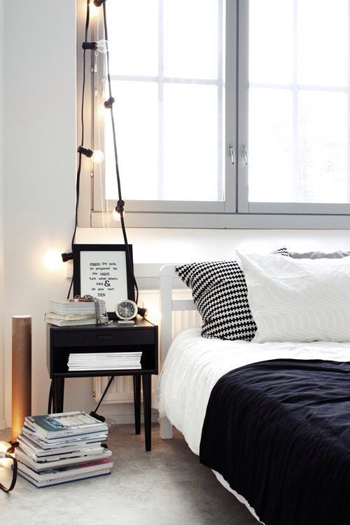 Drape string lights over your nightstand in place of a lamp, like in this example fromAlt Om Indretning.