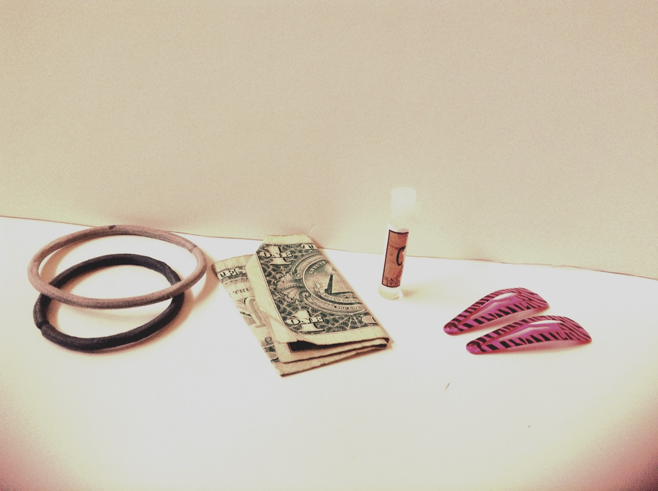 Some hair bands, cash, perfume sample and clips...