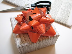In gift wrap emergencies when you've got the present but need some wrapping, here's an idea for turning a magazine page into a bow. This will save you tons of money especially since Christmas is coming up!