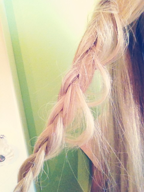 Take smaller parts from the braid and pull them out, creating a cool loop