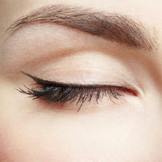 BRIGHTEN UP YOUR EYES: You don't need to go full-on smoky to make your eyes pop. After choosing your favorite eye shadow, line your eyes using a shade darker than your eye color (brown eyes will want to go with black or dark brown). Then top with a few coats of mascara, making sure to go all the way
