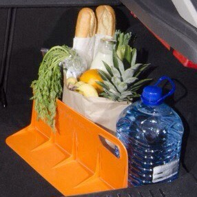 Use a book holder to keep your groceries from rolling around in your trunk.