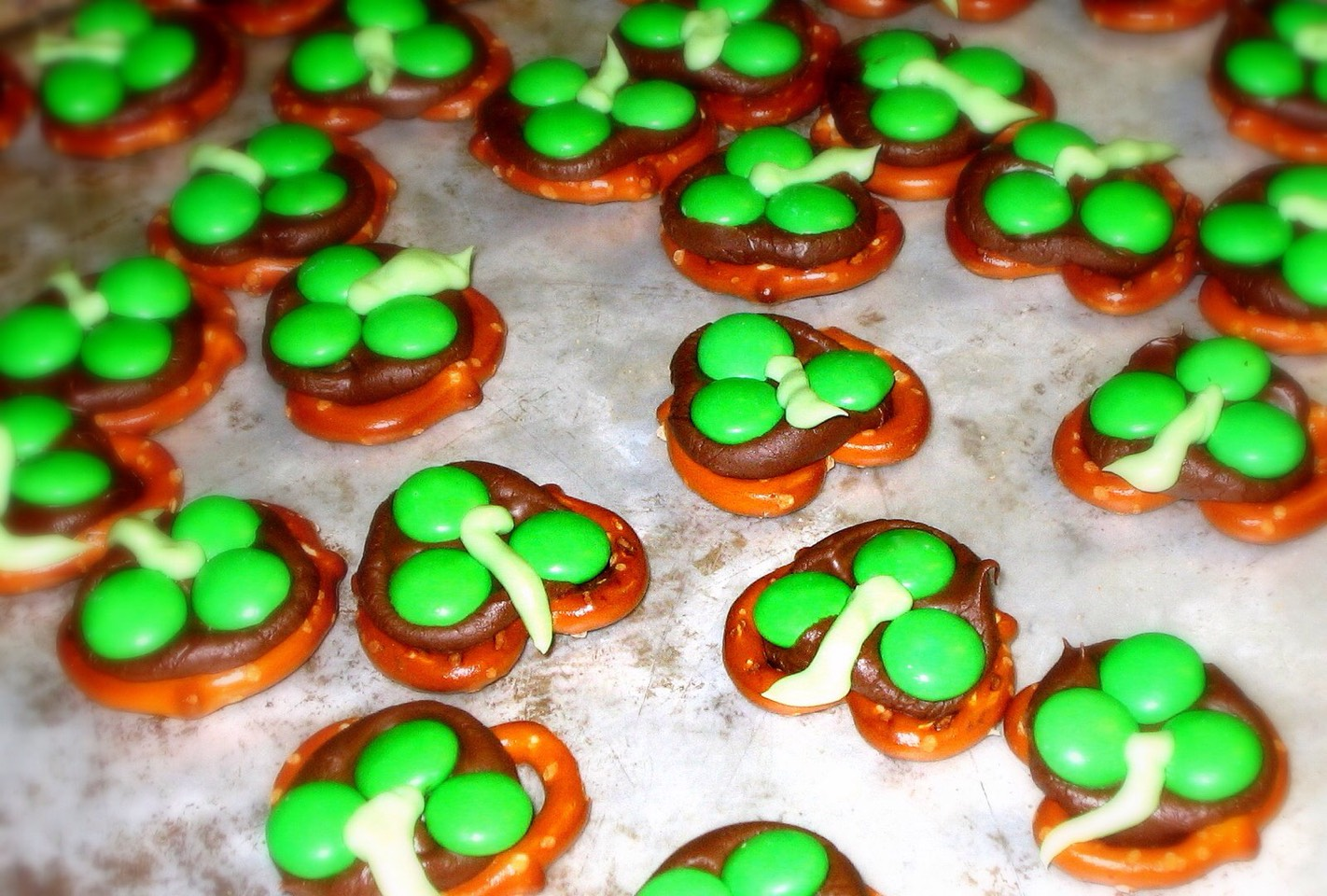 You'll need: -pretzels -Nutella  -green m&ms  Directions: Put pretzel on a plate evenly, put Nutella, on top and place 3 m&ms on the Nutella to make it look like a clover.