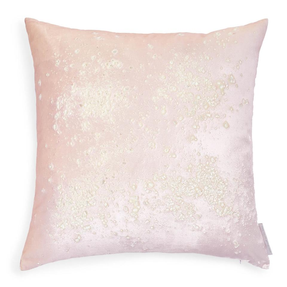 Bonus points: This pillow actually has pink quartz hand-pressed into the velvet for a very literal interpretation on the trend.