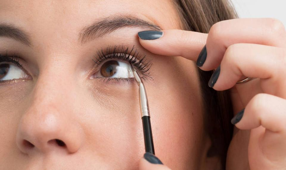 9. For a really natural look, tightline your liner by applying it in between the lashes instead of across the top of the lash line. The easiest way to do this is to fill in your top lashes from the underside. This will make your eyelashes look fuller but won't leave you looking too made up.