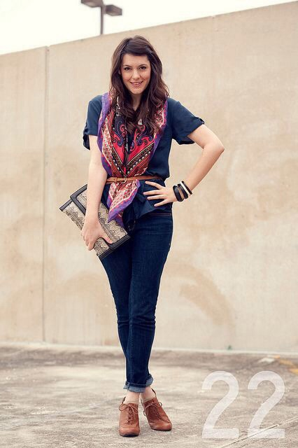 Tuck your scarf under a belt over a plain tee for a unique look.