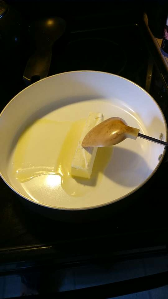 Put one stick of butter in the pan. (My spoon isn't dirty, just stained.)