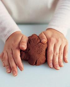 Turn out one-quarter of dough onto a cool, flat surface; flatten with your hands.