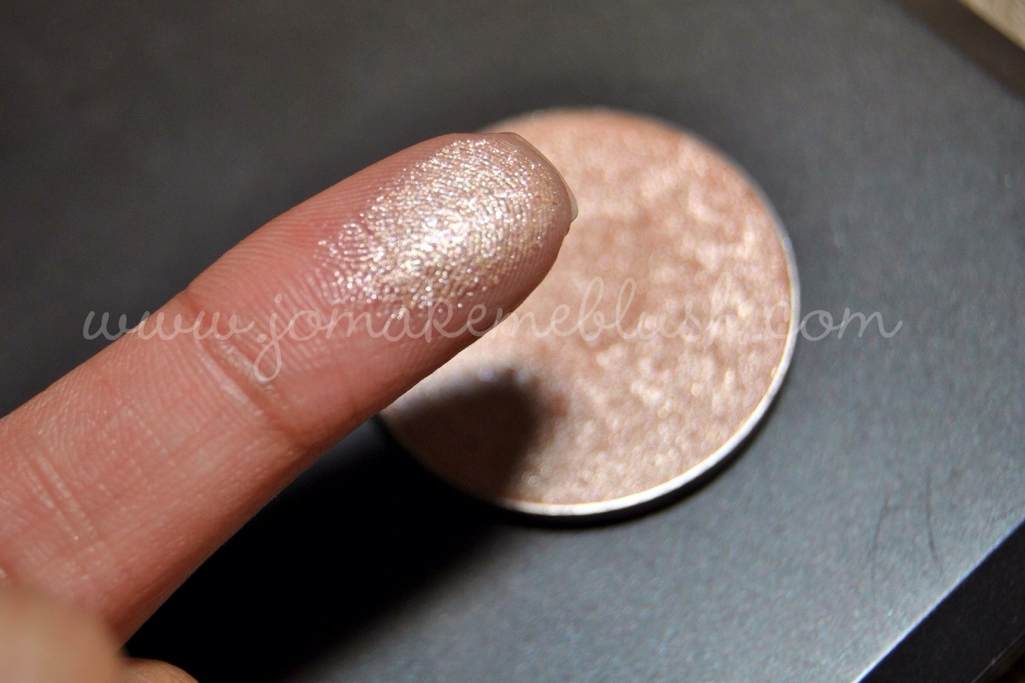 Put a shimmery nude eyeshadow on. ( something close to this )