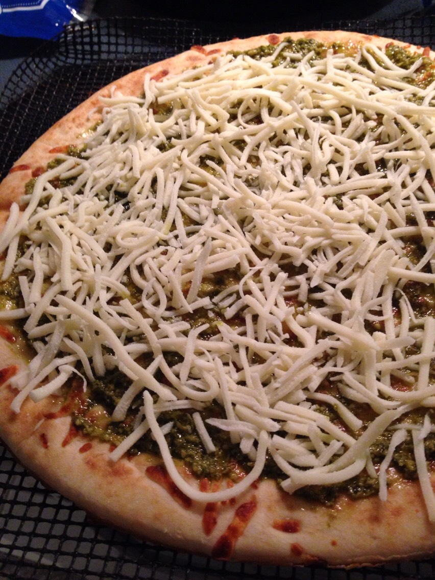 Take a premade pizza crust. Put your sauce marinara, pesto, or olive oil.  Add your cheese.