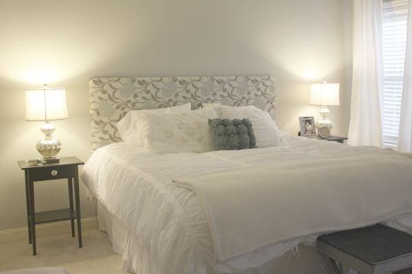 7. Nail hooks into the wall and hang your new headboard.