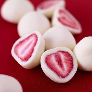 You can make them by dipping strawberries (halved or whole) in vanilla yogurt (Greek might be best, because it's thicker), then putting on a sheet pan lined with parchment or wax paper and freezing. Voila: Yogurt-covered strawberries!