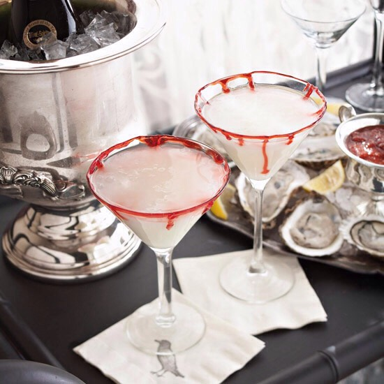 Bloody-Rimmed Martinis Startle your Halloween guests with this wicked brew. White chocolate, coconut, cream, rum, and vodka make a tasty martini, while red cake gel around the rim adds just the right amount of fright. For younger goblins, substitute lemonade or lemon-lime soda. Start to Finish: 10 m