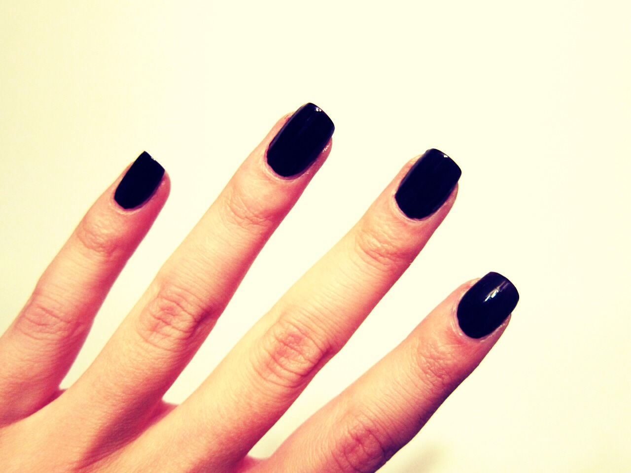 Paint your nails fully black
