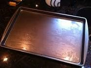 Place the peaches on a greased cookie sheet, I used olive oil but you could use non stick cooking spray. Don't use butter because the bottom of the puff pastry will burn.