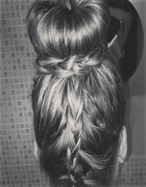 still with your heas upside down.. bobble your hair quite high on your head. undo the bit of left over plait now youve tied it off. what i usually do is put my donut in. when your donut is on your pony, spread the hair out like normal and put another bobble over to hold it in place. instead of then tucking the hair with bobby pins, i plait it all together around my bun then grip it in! and there you have it!! a super smart hair do in less than ten minutes! hope you like please share and like xxxx