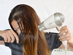 Dry your hair. Your hair will curl most effectively if it's dry. If it's soaking wet, you'll just end up damaging your hair and the curling process won't work. It can be just a little bit damp as well.