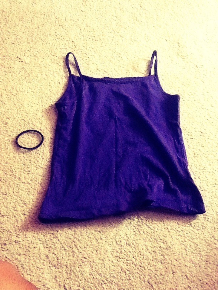 All you need is a tank top (preferably one with small arm holes) and a rubber band    TIP: I used a small tank top so my bag turned out small but if you want a big bag use a bigger tank top