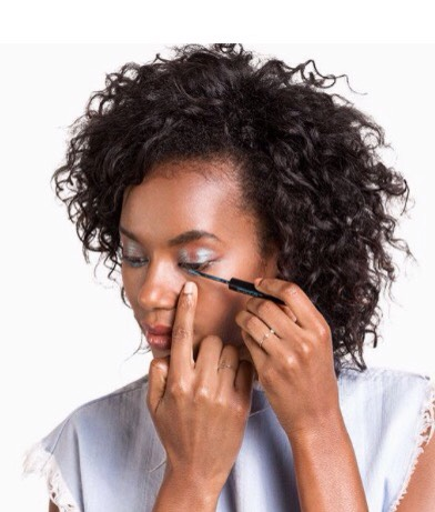 Step 3  Go over the lower lash line with a waterproof liquid eyeliner, dragging it into the corners of your eyes before flicking it out.