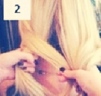 Get a piece of hair from the outside of one of the part, then put it over the part to the inside of the other part.