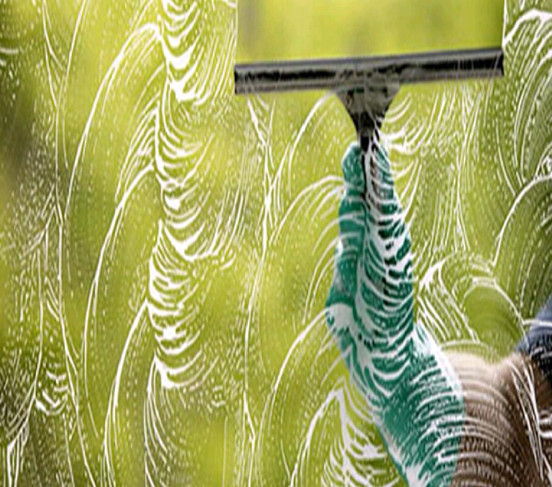 When you're washing windows squegy vertical on one side and horizontal on the other. If you have left a streak you'll know what side it is on. :)
