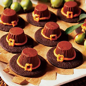 The base is a chocolate cookie I like to use the fudge stripes, take a mini peanut butter cup place over a flame for a second stick to cookie, pipe on hat brim and buckle super easy super quick... Please like