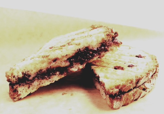 Make a chocolate spread sandwich and cut it in half...