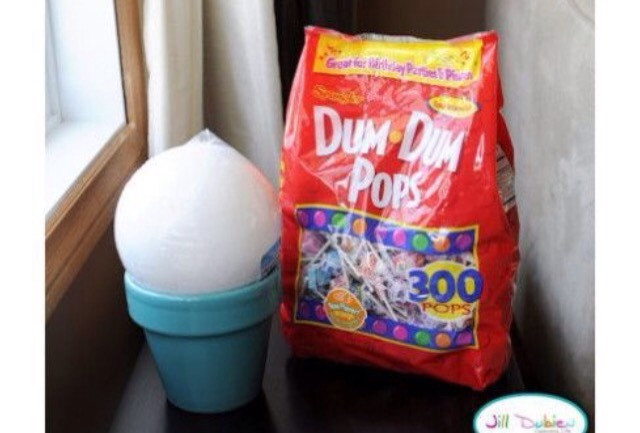 You will need some lollipops, a polystyrene ball, and a flower pot. Step 1. Glue the polystyrene ball onto the flower pot   Step 2. >