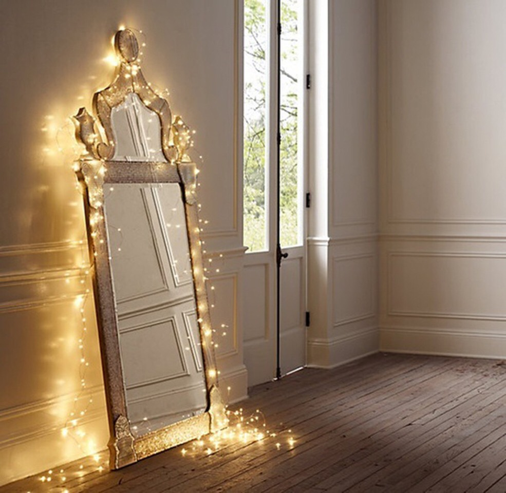3. Mirror Wrap: Wrap fairy lights around your mirror for a enchanted feeling in your room.