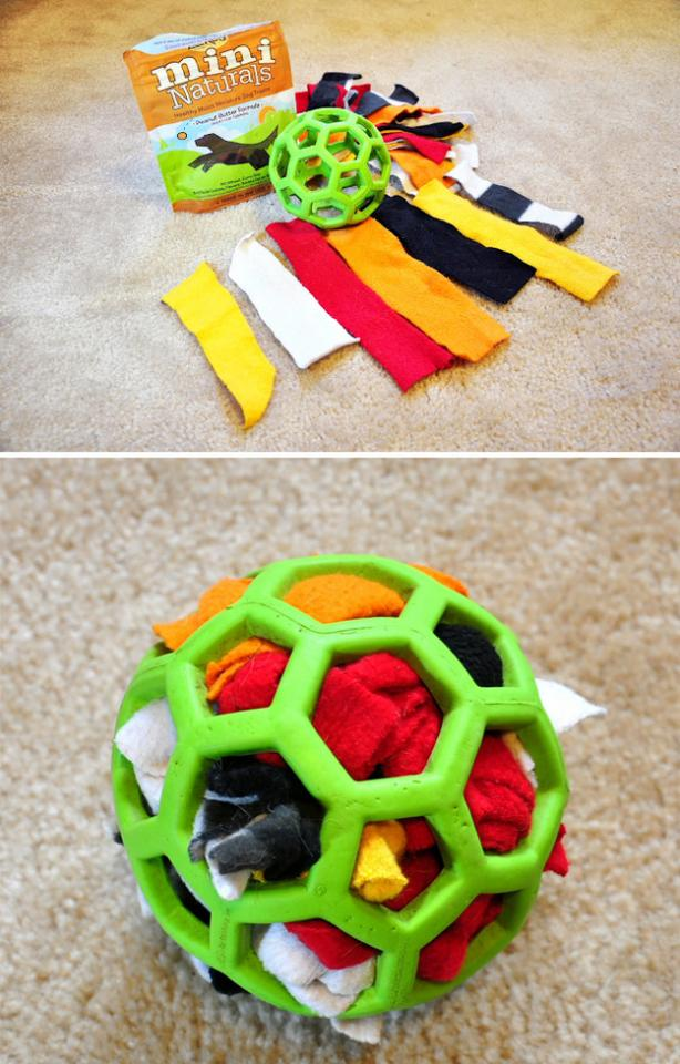 8. For a dog who loves to tear apart stuffed animals, make a durable activity ball with a Hol-ee rubber ball, scraps of fabric, and treats. Once your dog has removed all of the fabric from the ball, you can stuff the scraps right back in!