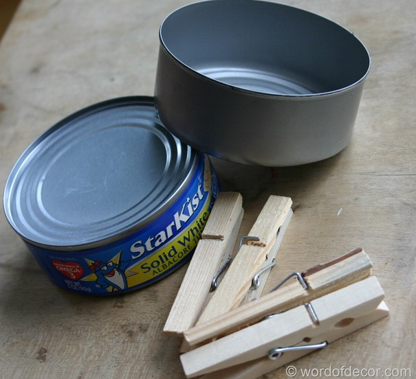 Materials needed - small tin cans and clothes pin holder