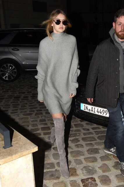 While traveling recently, the 21-year-old upped the ante on a slouchy sweaterdress with a pair of Weitzman's Highland suede boots in taupe.