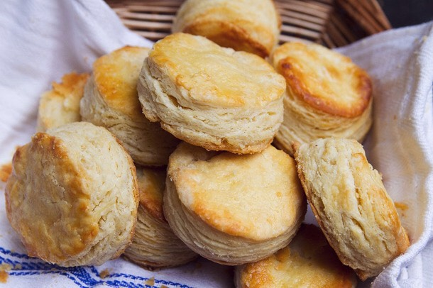 2 c. flour, sifted 1 tbsp. sugar 4 tsp. baking powder 1/2 tsp. salt 1/2 c. shortening (Crisco) 1 egg 2/3 c. milk  Sift together flour, sugar, baking powder, and salt into as bowl. Cut in shortening with a pastry blender until mixture resembles coarse meal. Combine egg beaten with milk. Add to flour mixture all at once, stirring just enough with fork to make a soft dough that sticks together. Turn onto lightly floured board and knead lightly 15 minutes. Roll to 3/4 inch thickness. Cut and place 1 inch apart on ungreased cookie sheet. Bake at 425°F for 12 minutes or until golden brown. Makes 12.