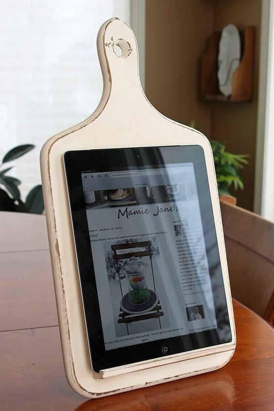 Transform an old cutting board into a tablet holder