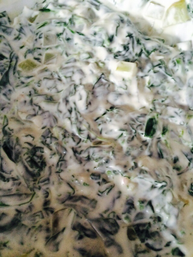 Mix the Sour Cream, Mayonaise, Dill and Green onions. Fold in the spinach.  I didn't have green onions or dill. So those little squares you see is chopped dill pickle. I also used dehydrated onion and about a tablespoon of pickle juice.