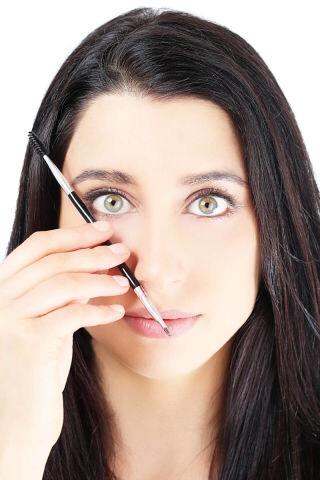 STEP 2  Angle the brush from the outside of your nose to the outer corner of your eye to fine where your brows should ideally end. The end of the brow's point should be at a 45 degree angle from the outside of the eye.
