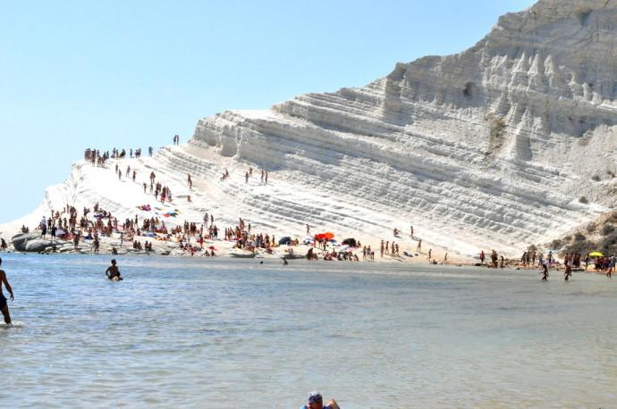 Scala Dei Turchi Through years of wave movement, a white rock of random stairs created itself naturally in southern Sicily, Realmonte, Italy.