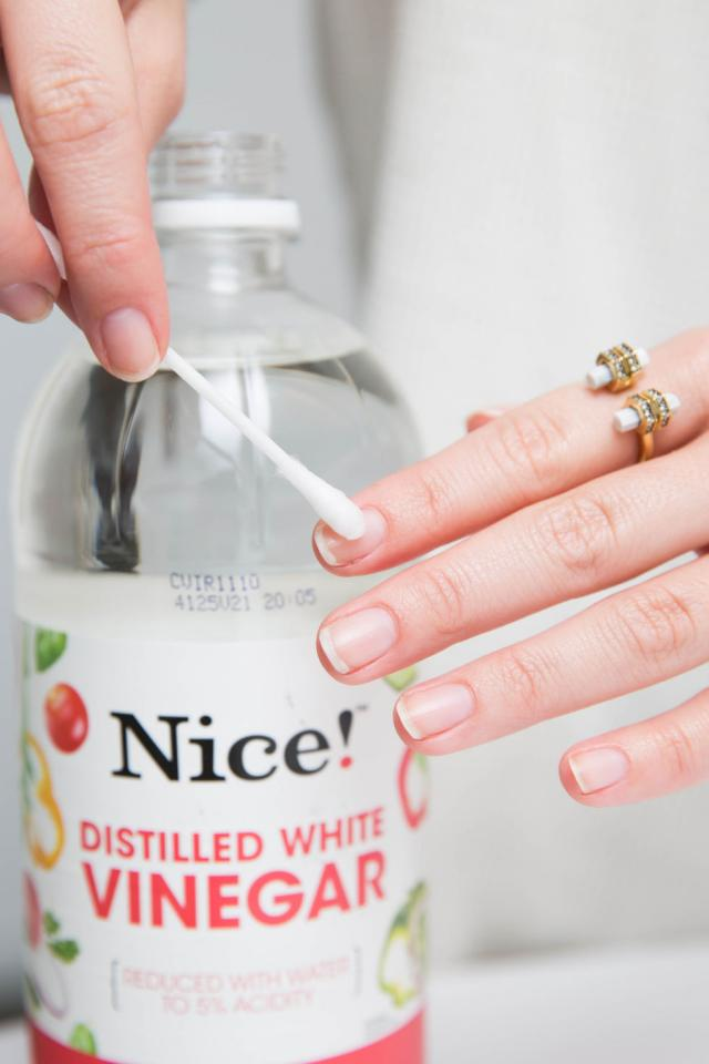1. Use a cotton swab to wipe down your nails with white vinegar before applying basecoat.  This removes any product buildup or natural oils on your nail beds that could create a barrier between the polish. Once your nails dry, apply basecoat.