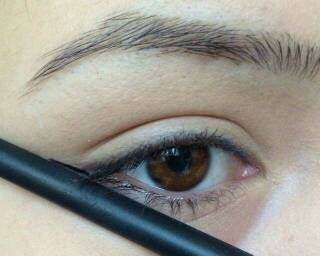 Using something with a straight edge, create a line starting from the outer corner of your eye.