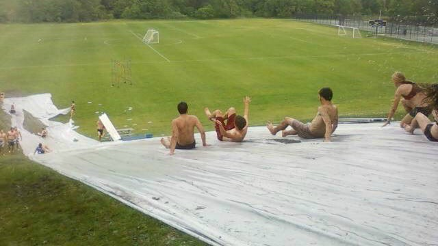 Make a slip-n-slip using a tarp, soap, and water! It's even more fun if you have a hill near bylike this one!