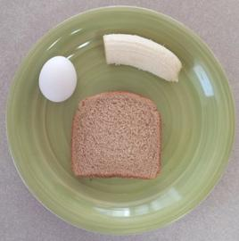 Day 2 Breakfast:      (1) hard boiled egg (78 calories)     (1) slice of toast (67 calories)     (1/2) banana (53 calories)  You may substitute (1) scrambled egg in place of the hard boiled egg. Try not to use salt or other additives.