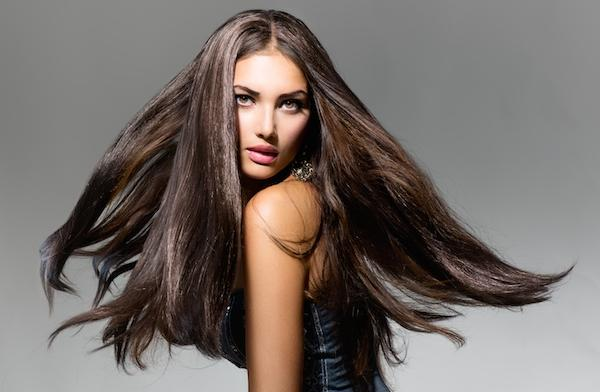 Use a light amount of mousse and a pomade to smooth your hair. Blow dry with a round brush. Use LOVE Conditioner by Davine. It works miracles.