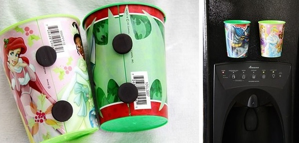 To prevent your kids from wasting lots of cups, give them their own and attach magnets to them so they can be stuck to the fridge.