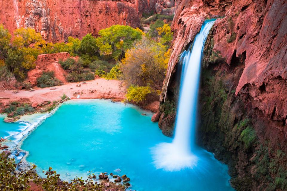 The Grand Canyon—explore the floor of the Grand Canyon for breathtaking finds like this, the cool blue Havasu Falls on tribal lands in Arizona.