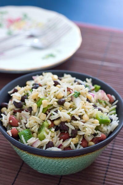 Beans and Rice SaladA great summer twist on the classic rice and beans. Chock full of yummy veggies, this salad could easily take the place of an entree.
